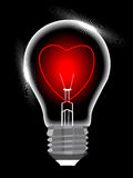 Light bulb with heart against black Stock Images