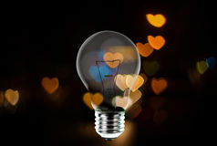 Light bulb with heart shape bokeh background Stock Photo