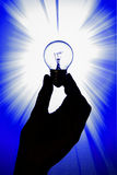 Light bulb held in hand. Shining light bulbe held in hand as a concept of idea Royalty Free Stock Images