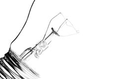 Light bulb highkey. Light bulb macro - highkey isolated on white, limited depth of field royalty free stock photos
