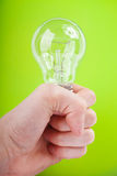 Light bulb in his hand Stock Photography