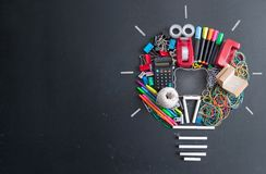 Light bulb icon made from stationery Stock Photos