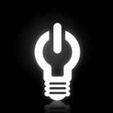 Light bulb icon. With power sign on black background Royalty Free Stock Photos