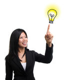 Light bulb idea. Southeast Asian woman hand pointing at  light bulb idea over white background Royalty Free Stock Photography
