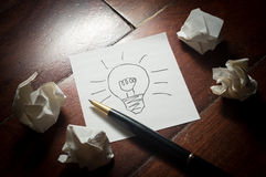 Light bulb idea in paper with pen. Royalty Free Stock Photo