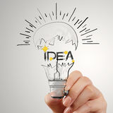 Light bulb and IDEA word design as concept. Hand drawing light bulb and IDEA word design as concept Stock Photography