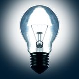 Light bulb illuminate in the dark Stock Photo