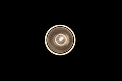 Light bulb illuminated and taken from above and isolated. Light bulb illuminated and taken from above and Black isolated Stock Photo