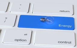 Light bulb illustrated on keyboard. Light bulb illustrated on computer keyboard with text graphics energy on blue key Royalty Free Stock Photos