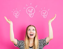 Light Bulb illustration with young woman. Reaching and looking upwards Stock Image