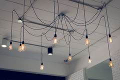 Light bulb incandescent hanging decorated interior Royalty Free Stock Image
