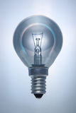 Light bulb with an iridescent glow on a contour. Stock Photography