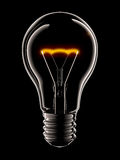 Light bulb. Isolated on black background Royalty Free Stock Photography