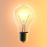 Light Bulb. Isolated on orange background Stock Photo