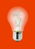Light bulb isolated on red background Royalty Free Stock Image