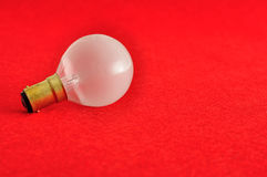 A light bulb. Isolated on a red background Royalty Free Stock Photo
