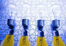 Light bulb on jigsaw Stock Photography