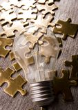 Light bulb on jigsaws Stock Photos