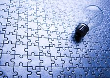Light bulb on jigsaws royalty free stock image
