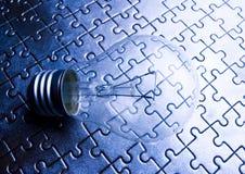 Light bulb on jigsaws Stock Photography