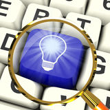 Light bulb Key Magnified Means Bright Idea Innovation Or Inventi Stock Images
