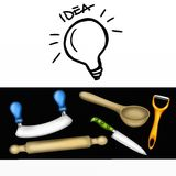 Light bulb and kitchen utensils Stock Photography