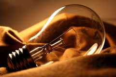Light bulb lamp. On brown cloth stock photos