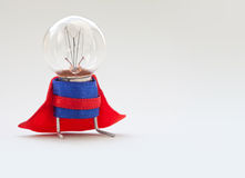 Light bulb lamp man in superhero costume. Vintage style lamp, stylized super hero character. Leadership and professional Stock Image