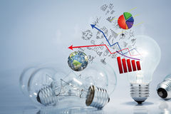 Light bulb lamps with business graph. (Elements of this image furnished by NASA Royalty Free Stock Photos