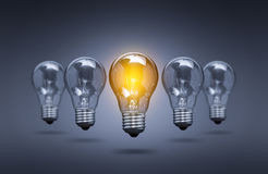 Light bulb lamps on a colour background. Royalty Free Stock Photo