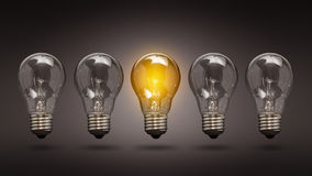 Light bulb lamps on a colour background. Royalty Free Stock Image