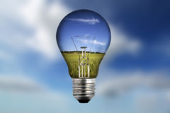 Light bulb with landscape inside Royalty Free Stock Photography