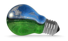 Light bulb with landscape reflection Royalty Free Stock Photos