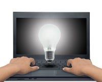 Light bulb laptop. Stock Photos
