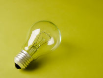 Light bulb laying on the geen background Stock Image