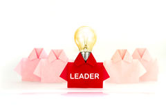 Light bulb with leader word in One Red among white origami shirt Royalty Free Stock Photography