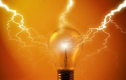 Light-bulb with lightning. A bulb in a warm reddish light hit by several lighting strokes Royalty Free Stock Image