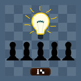Light bulb lit over pawns on a chess Board. Stock Photos