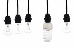 A light bulb with low consumption light bulbs hanging between Stock Images