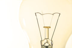 Light bulb macro with the filament wire and construction artisti Stock Images