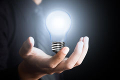 Light bulb in  man hand Royalty Free Stock Photos
