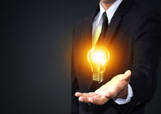 Light bulb in  man hand Stock Images