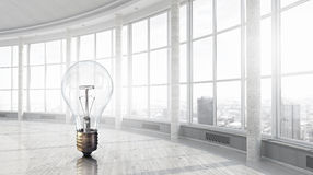 Light bulb in modern office Royalty Free Stock Images
