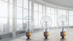 Light bulb in modern office . 3D render Royalty Free Stock Photography