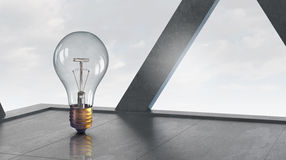 Light bulb in modern office . Mixed media Royalty Free Stock Photo
