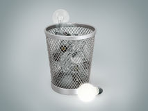 Light bulb near a bin with other lamps. Concept of lost idea Royalty Free Stock Image