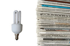 Light bulb and new newspapers Stock Image