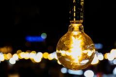 Light bulb at night. Bokeh Stock Image