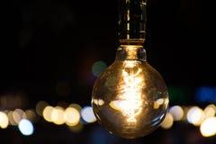 Light bulb at night. Bokeh Royalty Free Stock Photos