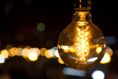 Light bulb at night. Leaves Stock Photos